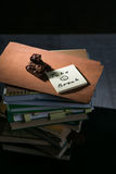Часть шоколада на стоге книг Стоковая Фотография RF
