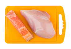 Часть salmon и сырцовой куриной грудки Стоковые Фото