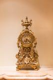 часы золотистые Стоковые Изображения