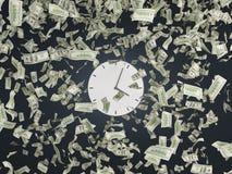 Часы и падая доллары Стоковые Фотографии RF