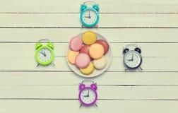 Часы и печенья Стоковое Изображение