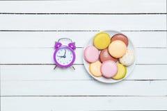 Часы и macaron Стоковое Изображение