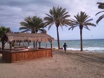 Часы досуга на пляже стоковая фотография
