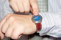 часы показа персоны Стоковое Фото