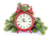 Часы рождества и ель снега Стоковая Фотография