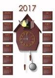 Часы с плитками календаря 2017 коричневыми Стоковое фото RF