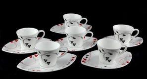 6 чашек на черной предпосылке Стоковые Фотографии RF