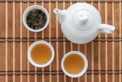 Чашек чаю с чайником Стоковые Фото