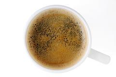 Чашка взгляд сверху черного кофе на белой изолированной предпосылке Стоковое фото RF