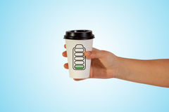 чашка взятия удерживания руки Стоковые Фото