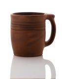 Чашка глины на белой предпосылке Стоковая Фотография