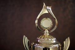 Чашка золота для победителя 1-ое вознаграждение места Стоковое Изображение