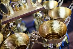 Чашка золота для победителя 1-ое вознаграждение места Стоковая Фотография
