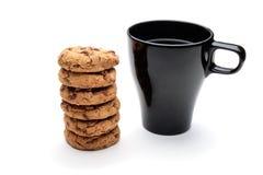 Чашка и печенья Стоковые Фото