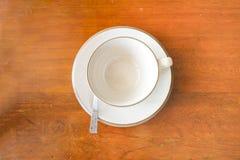 Чашка и поддонник Стоковая Фотография
