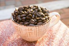 Чашка и фасоль Coffe Стоковое Фото