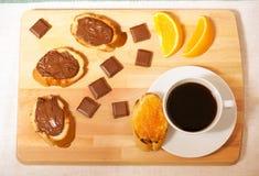 Чашка кофе, здравицы с вареньем и распространение фундука Стоковые Изображения RF