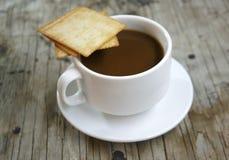 Чашка кофе и печенья Стоковые Изображения