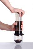 Чашка кофе и aeropress Стоковые Изображения