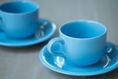 Чашка кофе на серой предпосылке Стоковое Изображение