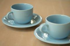 Чашка кофе на серой предпосылке Стоковое фото RF