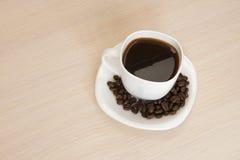 Чашка кофе на таблице Стоковая Фотография RF