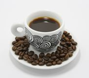 Чашка кофе с кофейными зернами Стоковое Изображение