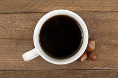 Чашка кофе с фундуком Стоковое Изображение