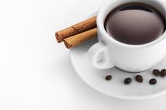 Чашка кофе с циннамоном и фасолями Стоковые Фото