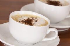 Чашка кофе с шоколадом брызгает Стоковое фото RF