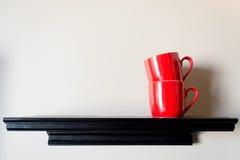 Чашка красного цвета пар Стоковые Фото