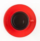 Чашка на взгляде поддонника сверху, изолированный на белой предпосылке Стоковая Фотография