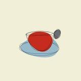 Чашка руки с поддонником и кофе Стоковое Фото