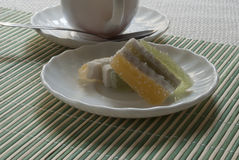 Чашка с чаем и помадками Стоковые Изображения RF