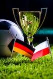 Чашка футбола и флаги заполированности и немца Стоковая Фотография RF