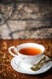 Чашка чаю на деревянной предпосылке Стоковые Фото