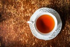 Чашка чаю на деревянной предпосылке Стоковая Фотография RF