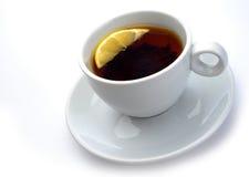 Чашка чаю с лимоном стоковое изображение
