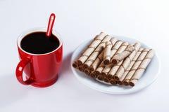 Чашка черного кофе, печений, сладостных ручек Стоковое фото RF