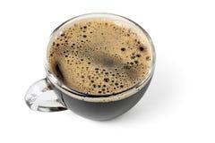 Чашка черного кофе при пена изолированная на белой предпосылке Стоковые Изображения