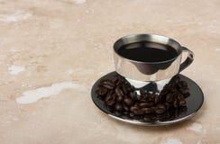 Чашка espresso нержавеющей стали на поддоннике Стоковые Изображения