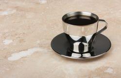 Чашка espresso нержавеющей стали с поддонником Стоковые Изображения