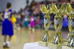 Чашки и награды в танцах бального зала Стоковая Фотография