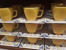 Чашки и поддонники стоковые изображения rf