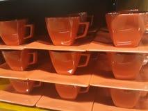 Чашки и поддонники стоковая фотография