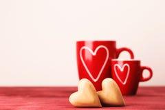 2 чашки и 2 сердца Стоковая Фотография