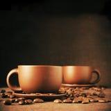 Чашки кофе и кофейные зерна Стоковая Фотография