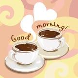 2 чашки кофе на абстрактной предпосылке Стоковое Изображение
