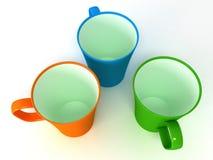 3 чашки на белой предпосылке Стоковые Изображения