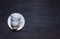 2 чашки на плите Стоковое Фото